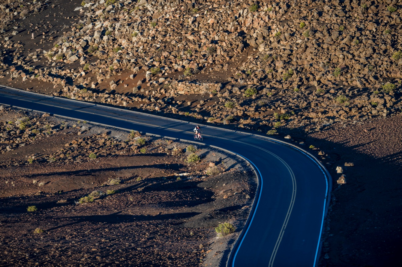 Summit4CAD Founder Jon Patrick Hyde cycling to the summit of Mt. Haleakala