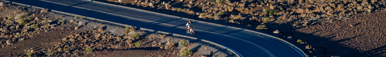Summit4CAD Founder Jon Patrick Hyde cycling to the summit of Mt. Haleakala