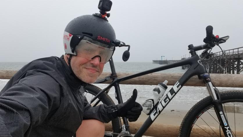 Jon Patrick Hyde At the Goleta Pier in the rain on my trusty Eagle Bicycles Patriot Mountain Bike.